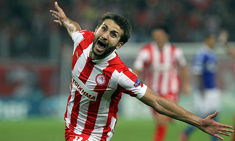 Olympiakos's Djamel Abdoun celebrates scoring against Schalke in Champions League Group B