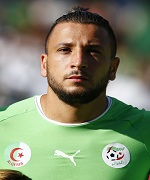 Algeria's Ghilas listens to the national anthem before their friendly soccer match against Armenia in Sion