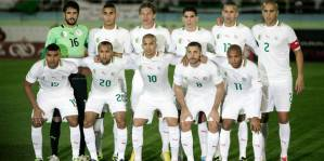 In this Nov. 19, 2013 file photo, Algeria's national soccer team poses prior to the start the World Cup qualifying soccer match between Burkina Faso and Algeria in Blida, Algeria. Background from left: Mohamed Lamine Zemmamouche, Faouzi Ghoulam, Mehdi Mostefa-sbaa, Carl Medjani, Islam Slimani and Madjid Bougherra. Foreground from left: El Arbi Hillel Soudani, Nacereddine Khoualed, Sofiane Feghouli, Medhi Lacen, Yacine Brahimi. The draw for the 2014 World Cup finals takes place Friday Dec. 6, 2013 near Salvador, Brazil. The 32 teams will be drawn into eight groups of four. The top two in each group will progress to the knockout stages. Twelve stadiums in twelve cities will host matches. ( AP Photo/ Anis Belghoul, File)  Associated Press / Reporters